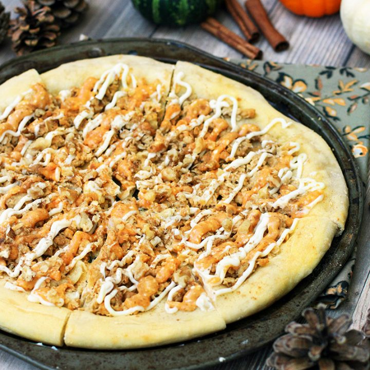 Pumpkin spice dessert pizza: Pizza crust, strusel topping, and pumpkin spice icing.