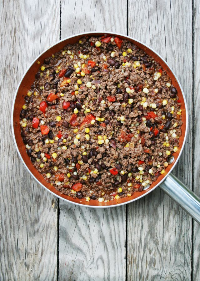 Mexican ground beef skillet: Hamburger, veggies, flavorful sauce, and toppings make for a delicious dinner or appetizer recipe.