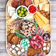 Create a holiday grazing board on a budget! Learn how to assemble a snack board for your Christmas party!