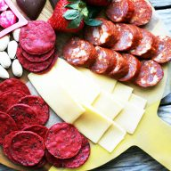 A Valentine's Day snack board: Red, pink, and white snacks perfect for a Valentine's Day celebration.