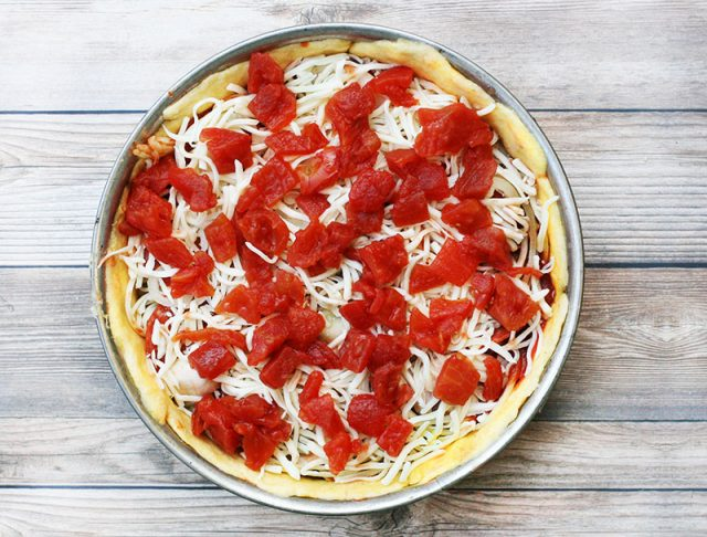 Deep-dish pizza at home: Top with crushed tomatoes for an authentic Chicago-style pie.