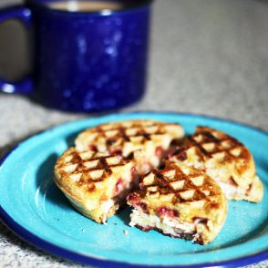 Make a sandwich out of frozen waffles! This one is made with turkey, cream cheese, and raspberry jam. Click through for more frozen waffle hacks.