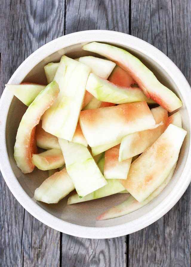 How to make watermelon rind pickles: Cut and peel the watermelon rind.
