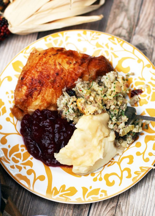 A grain-free Thanksgiving plate, with paleo-friendly stuffing that's made from cauliflower, sausage, and apple.