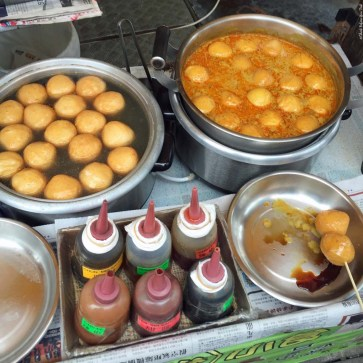 Fish balls in sauce sold by a street vendor in Hong Kong, China