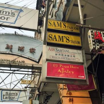Signs on Nathan Road directing you to Sam's Tailor - Tsim Sha Tsui, Hong Kong, China