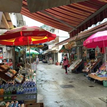 Street with shops in Yung Shue Wan, Lamma Island - Hong Kong, China