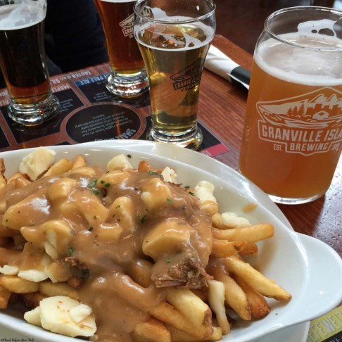 Beer and Poutine at Granville Island Brewing on Granville Island - Vancouver, British Columbia, Canada