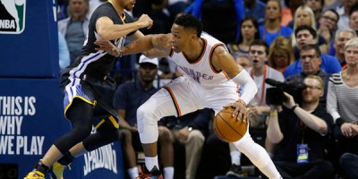 Oklahoma City Thunder guard Russell Westbrook, right, drives against Golden State Warriors guard Stephen Curry during the second quarter of an NBA basketball game in Oklahoma City, Saturday, Feb. 27, 2016. (AP Photo/Sue Ogrocki)