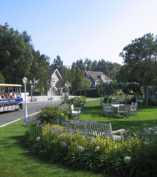 A sight seeing troley shows visitors around Wisteria Lane in Universal Studios. In the background Mike and Bree's house