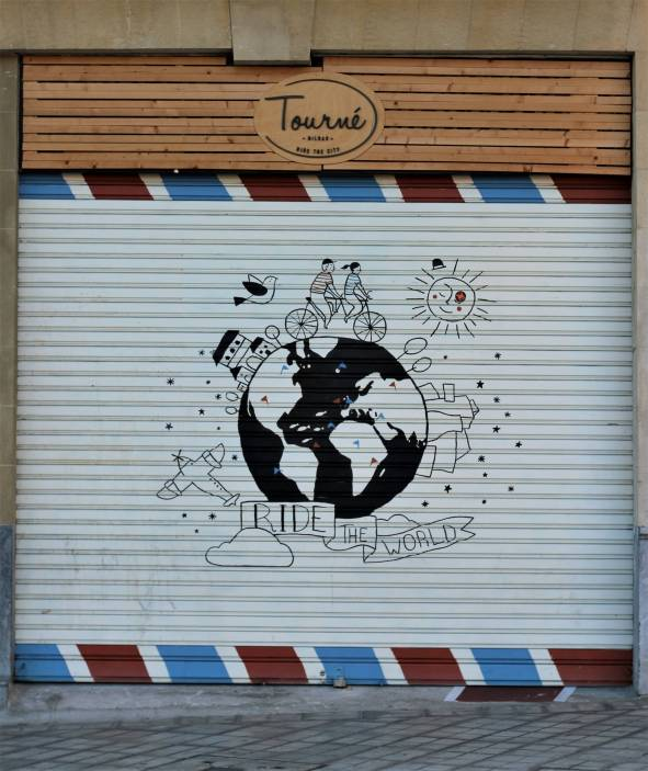 Street art drawn shopping window cover Bilbao