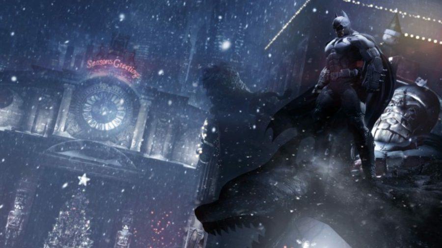 Batman standing on a gargoyle above the city