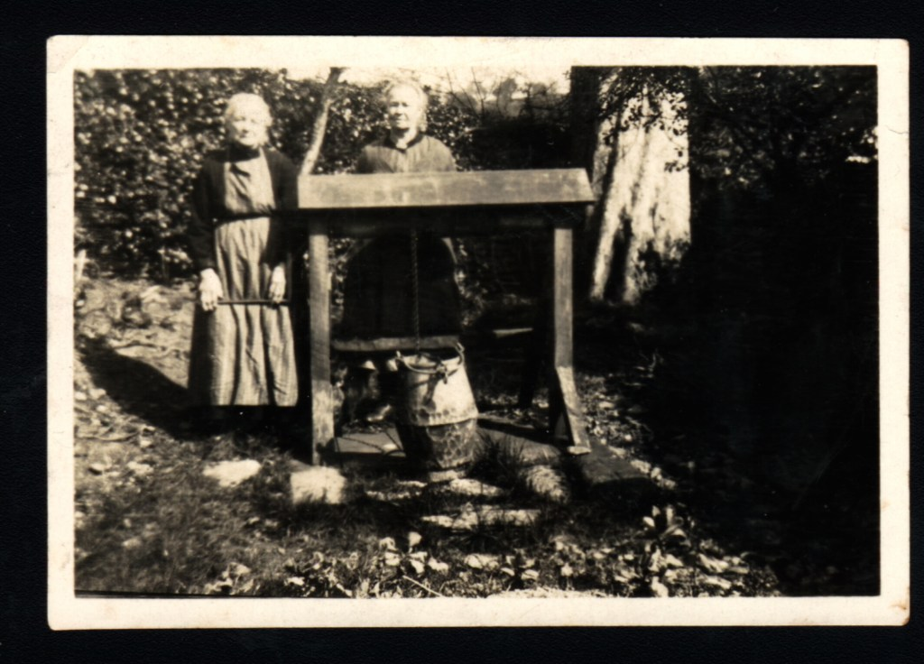 Photograph with two of myAndrew Collett's Great Aunts standing by the well in the garden of Badger Cottage, believe taken circa 1900-1910.