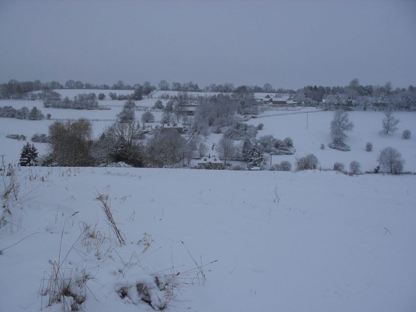 Looking across to Middle Chedworth from above Green Lane