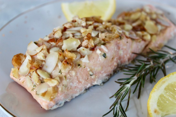 This simple nut-crusted salmon takes just 5 minutes to whip up and is on the table in under 30 minutes! The honey mustard glaze topped with nuts is the perfect combination of sweet and savory