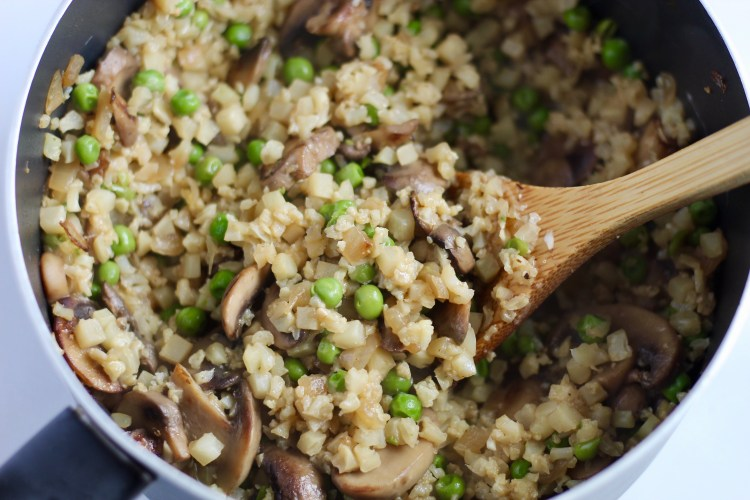 This creamy Mushroom Cauliflower Rice Risotto is a lighter alternative to regular risotto. Plus, it calls for just a few simple ingredients, and cooks up in 20 minutes flat. Naturally gluten-free and vegan option! #healthyrecipes #vegetables #cauliflowerrice #sidedish