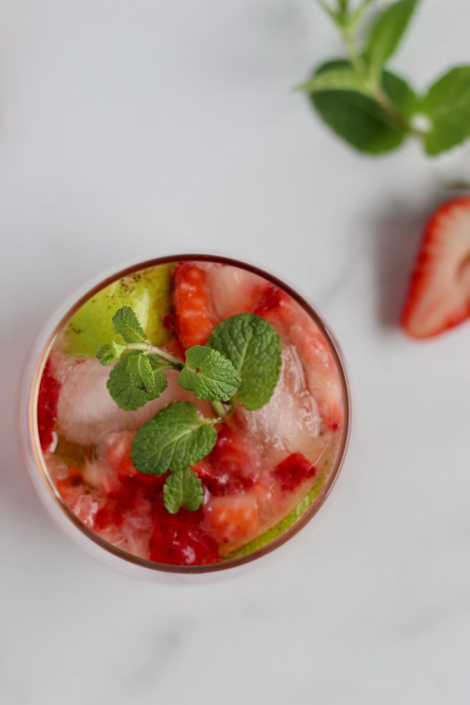 This light Strawberry Rosé Mojito is an elegant spin on the classic mint mojito. Unlike most sugary cocktails, this drink is only 100 calories and includes both sugar-free and low-sugar options. #healthydrinks #lowersugar #summercocktail #mojito
