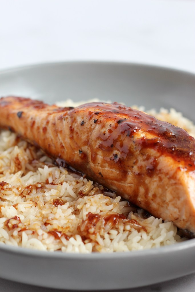 This Honey Soy Glazed Salmon is simple, yet so delicious. Fresh grilled or pan seared salmon fillets are topped with a flavorful glaze that you'll want to eat on repeat. #SalmonRecipes #HoneySoy #Grilling #Umami