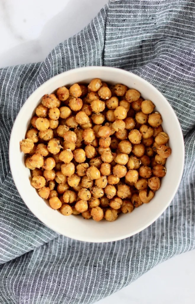 Close up of roasted chickpeas in a white bowl