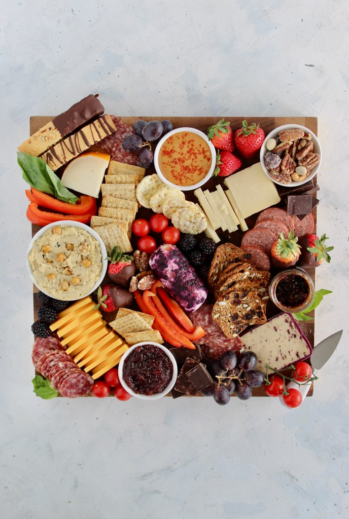 Learn how to make the perfect Valentine's Day Charcuterie Board for your loved ones. This customizable board is filled with all the good stuff like cheeses, meats, dips, fresh fruit, vegetables, and sweet treats.