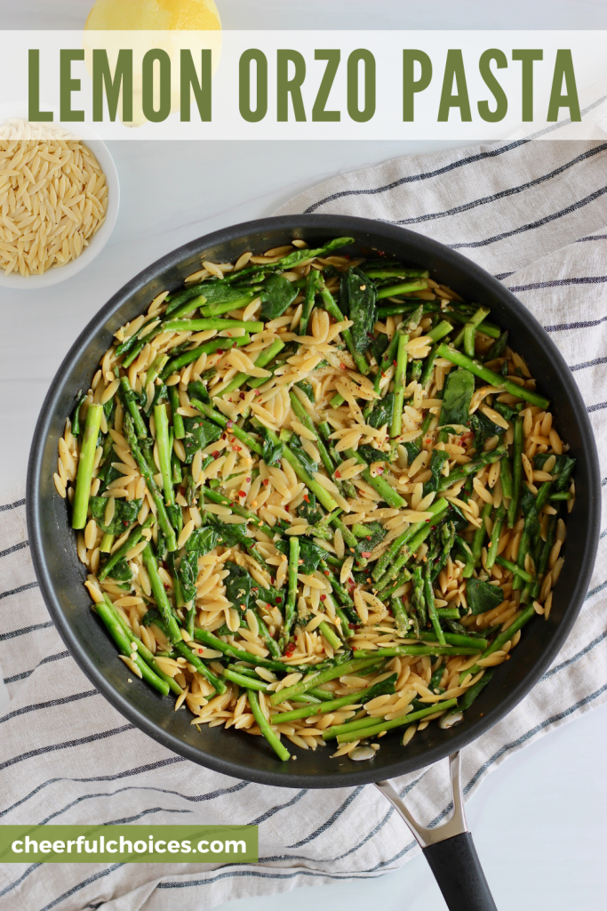 Lemon Orzo with Asparagus is the perfect healthy side dish to add to your Easter menu or weeknight dinner plan! This one pan recipe calls for simple ingredients and comes together in just 30 minutes. Serve alongside fish, chicken, or chickpeas for extra protein. #OrzoRecipes #Asparagus #SpringPasta