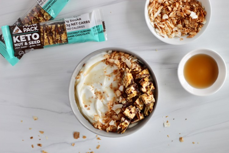 Yogurt bowl with toasted coconut and agave