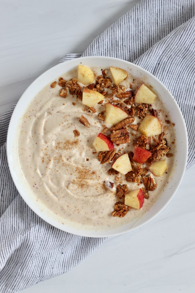 Apple smoothie bowl in a white bowl