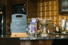 """Sign on countertop that reads """"Welcome to Cheers B&B"""""""