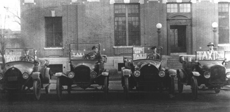 Taxi Model T cars lined in front of the Old Post Office