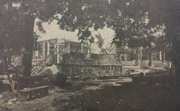 Aug. 1, 1910: Walls begin to rise under tall shade trees