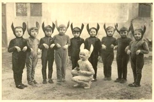 several children dressed in creepy rabbit costumes. Black and white, vintage
