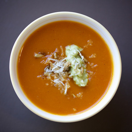 Butternut squash and casabel chile soup with sunflower seeds, grated romano cheese and whipped avocado