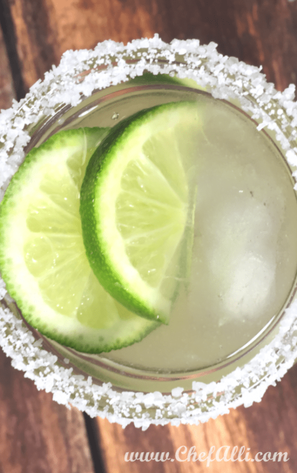 Is there anything as refreshing as a GOOD margarita? Pitcher Margaritas are ideal for family gatherings, game nights, watching sports, or celebrating the holidays! Whatever the occasion, make sure you always have the ingredients on hand to whip up these EASY Pitcher Margaritas to enjoy. #pitchermargaritas #margaritasforaparty #partydrinks