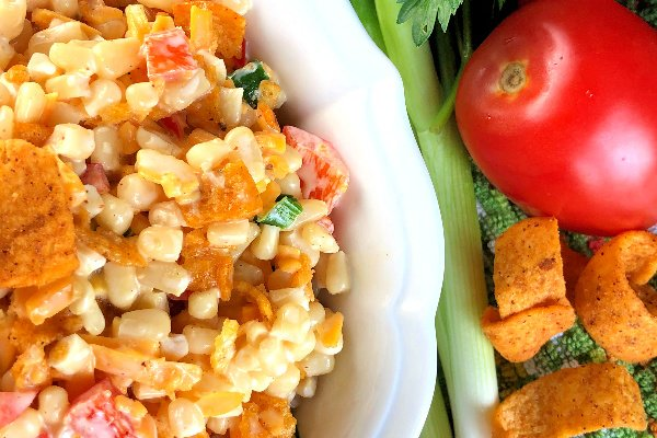 I totally ADORE corn salad, especially Crunchy Corn Salad with Fritos! In my opinion, all corn salad is delicious in every sort of way - so refreshing during those hot summer months.