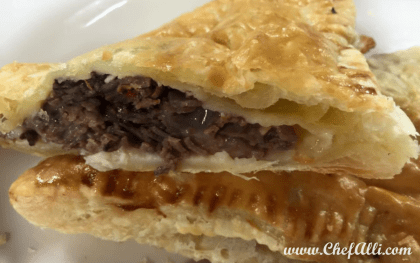 """If you love beef, like my family does, then you will adore these cheesy Roast Beef pies in puff pastry, better known as Roast Beef Wellington Packets. To satisfy the hard-working appetites in my house, these meat-filled (and portable, if necessary) """"hand pies"""" hit the spot every time. Who wouldn't love in a flaky puff-pastry crust filled with roast beef, mushrooms, and swiss cheese dipped in a zippy horseradish sauce?!"""