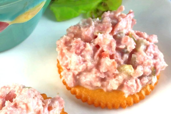 Ham Salad! Such a great way to use up leftover ham.  In just a few minutes you can have a batch of this Easy Ham Salad whipped right up in your food processor and all you need are a few ingredients.  Before long, you'll be stuffing ham salad sandwiches into your mouth like a mad woman - it's grand.