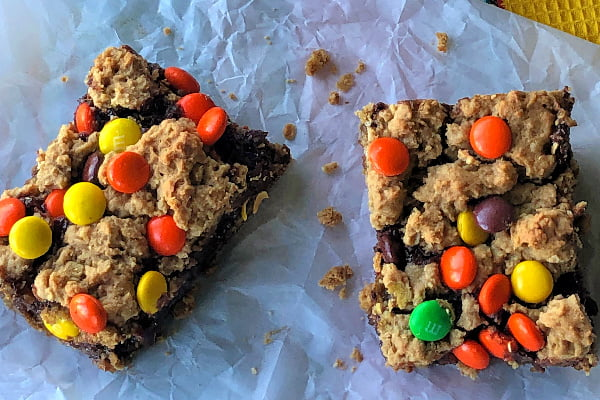 I love a good bar cookie recipe - they save so much time! Peanut Butter Polka Dot Bars bring together creamy peanut butter, dark brown sugar, and oats to make a rich base, topped with a layer of chocolate and sprinkled with Reese's Pieces.