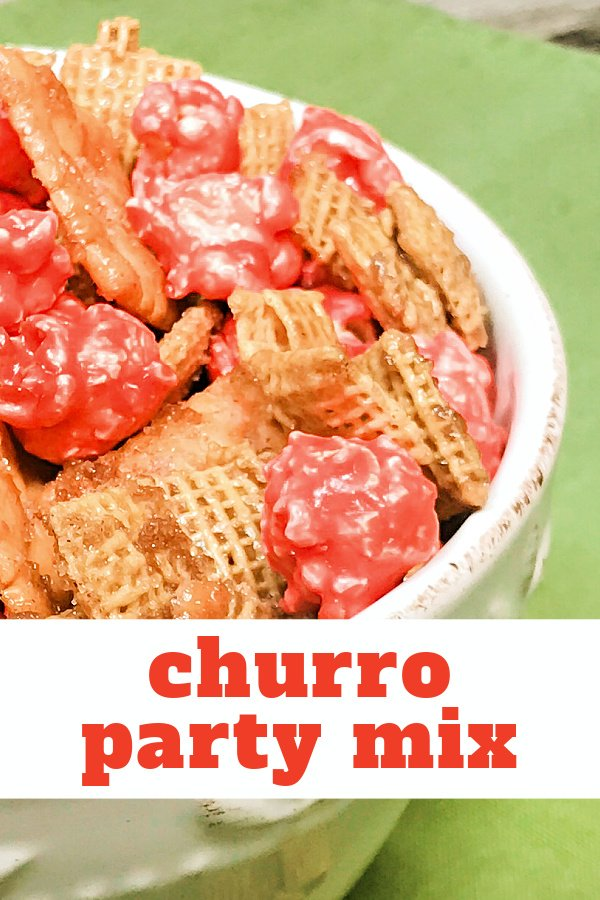 Churro Snack Mix in a piled into a white bowl.