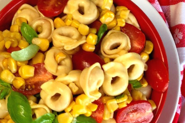 If there's any salad that tastes like summer, this Tortellini Pasta Salad with Tomatoes, Basil and Corn absolutely has to be it.