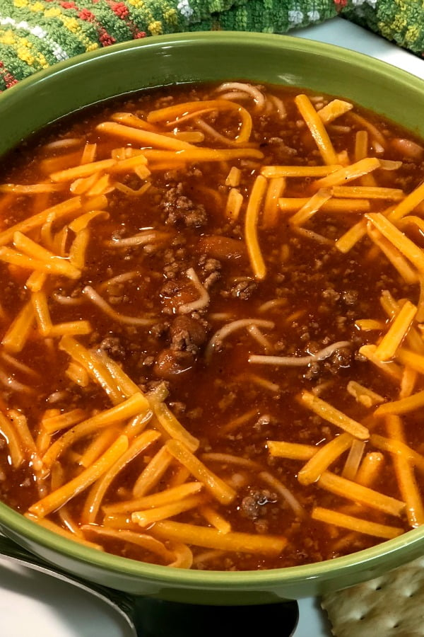 Hillbilly Chili served in big bowls in perfect served beside a warm cinnamon roll.