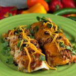 These Chicken and Bacon Black Bean Enchiladas make a fun weeknight meal and I love to double this recipe to make TWO pans - one for dinner now and one for dinner later....then I pull that sucker right out of the freezer. And, this casserole makes a pretty neat gift when somebody's grieving a loss or celebrating a birth - who doesn't love a pan of enchiladas delivered to their door when in need??   #chicken #bacon #enchiladas #casserole
