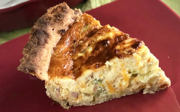 Who loves breakfast quiche for any meal of the day??  If you raised your hand, then you definitely need this quiche recipe.  My family scarfed it right down! This Easy Deep Dish Ham and Broccoli Quiche is incredibly delicious and such an easy recipe to whip up.  You only need a few basic ingredients on hand....eggs, cream, broccoli, and ham and you've got a meal all ready to hit the dinner table. #Breakfast #Brunch #Ham #Bacon #EasyMeal #Eggs #Cheddar