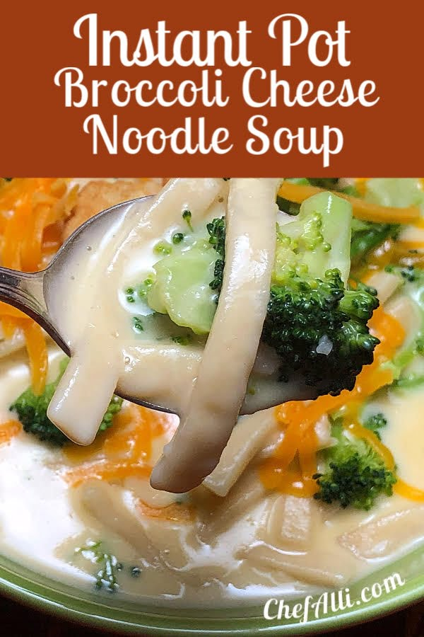 Close up of a spoonful of broccoli cheese noodle soup.