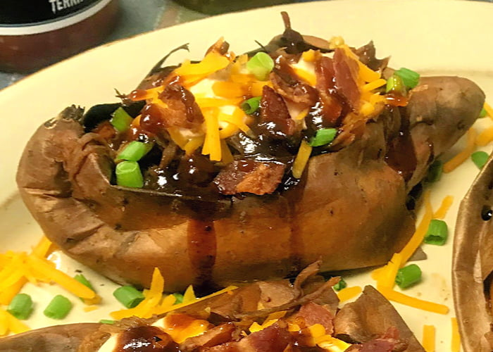 Loaded BBQ Pulled Pork Sweet Potatoes make an easy quick meal.