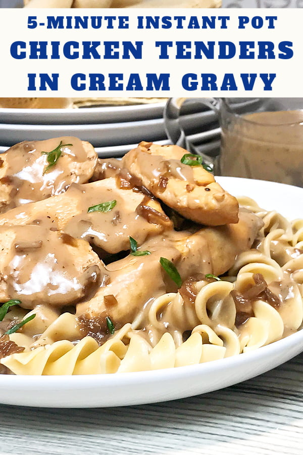 Chicken tenders piled on a bed of pasta topped with gravy.