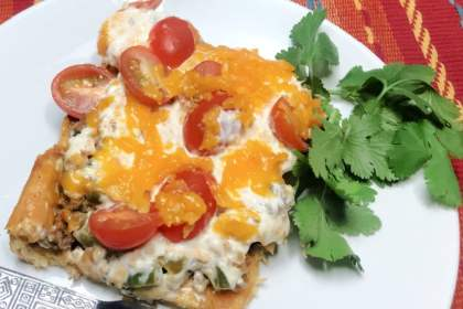 Cowgirl Casserole with a creamy ground beef filling topped with shredded cheese.