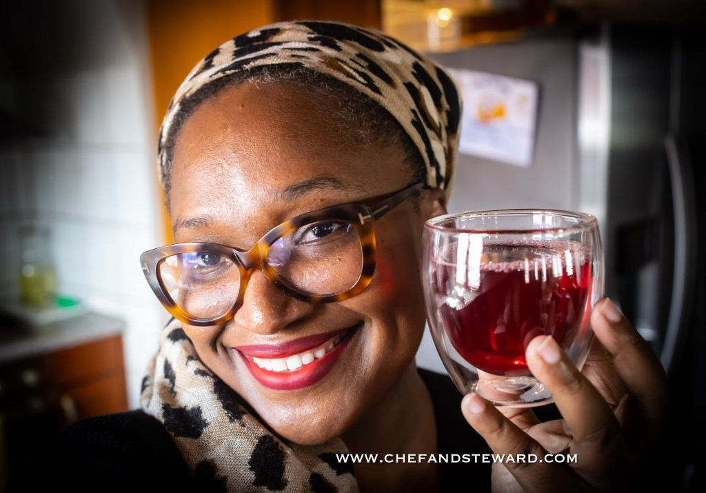 Woman holding sorrel hibiscus Agua de Jamaica Zobo sobolo karkade drink