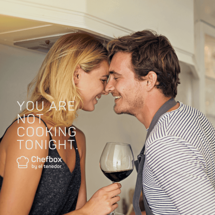 image of couple sharing a glass of wine.
