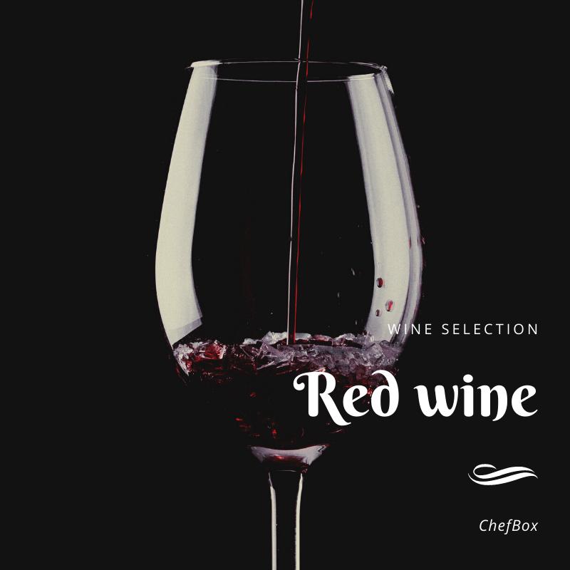 Red wine glass in a dark background.
