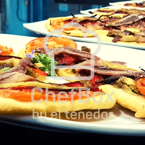 Flatbread with roasted vegetables and anchovies.
